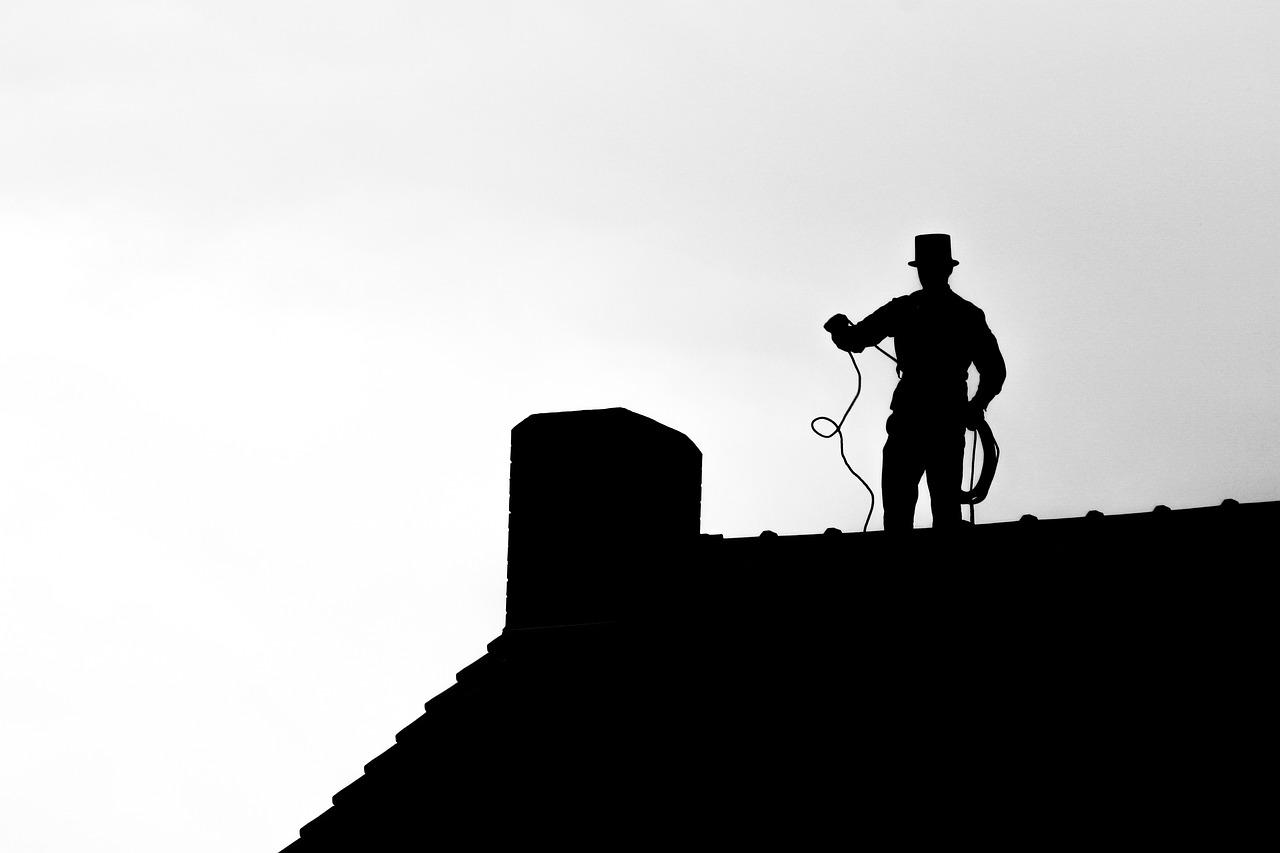Schornsteinfeger auf Dach